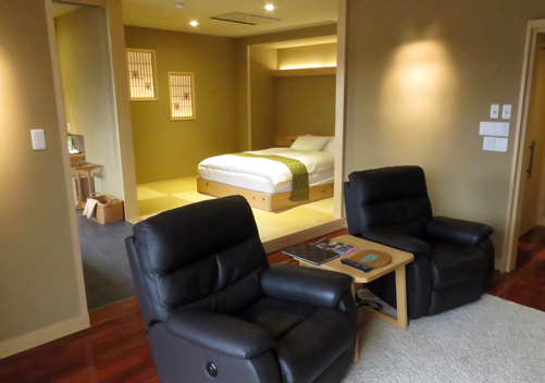 A deluxe western room with private onsen