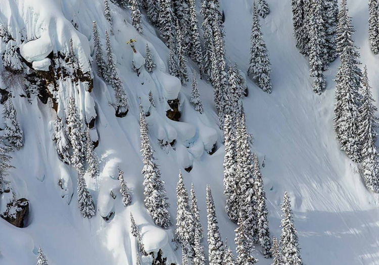 Eagle Pass HeliSkiing | Lynsey Dyer riding the pillows | Photograher: Grant Gunderson