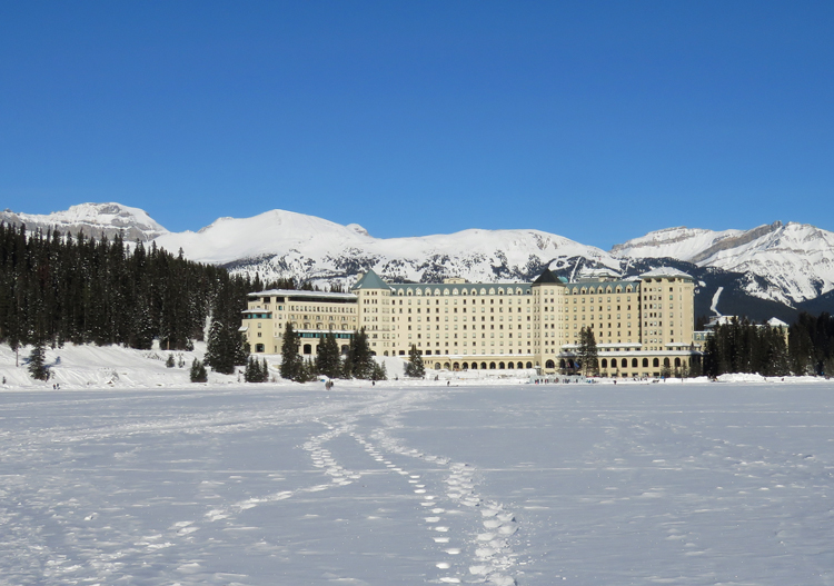 The frozen lake is adjacent to the Chateau Lake Louise