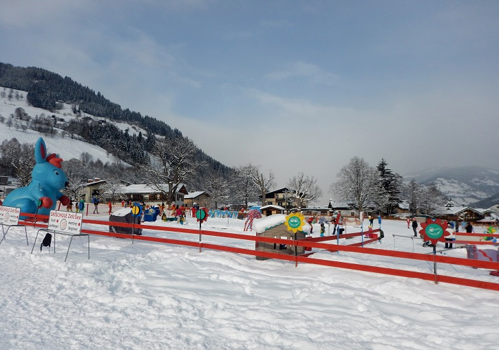 Child friendly skiing at Zell am See ski resort's Schuttdorf base area.
