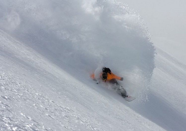 Ride deep powder at Eskimo Freeride cat skiing.