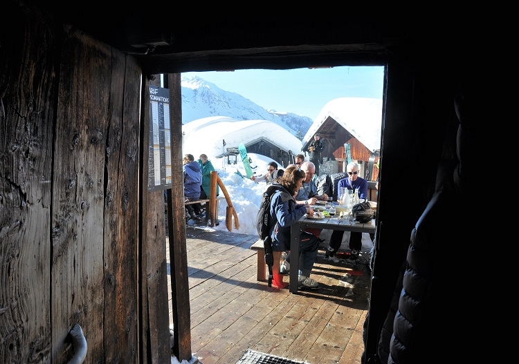 Enjoy gourmet French cuisine in mountain huts at Sainte Foy ski resort.