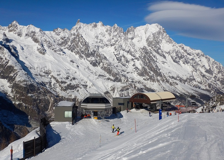 Courmayeur ski resort Italy, below huge Monte Bianco (Mont Blanc).