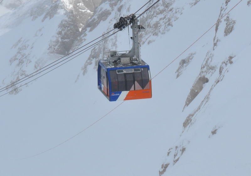 A series of 3 cable cars make the journey up the Marmolada glacier.
