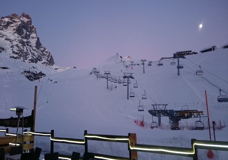 Evening twilight and rising moon make a splendid Cervinia apres setting.