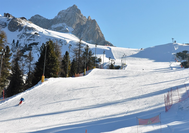 Wide and crowd-free intermediate ski terrain at Faloria in Cortina.