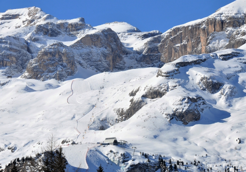 The Vallon chairlift and trail high above Corvara in Alta Badia ski resort.