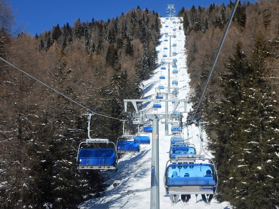 Modern, comfortable Folgarida Marilleva ski resort chairlift.