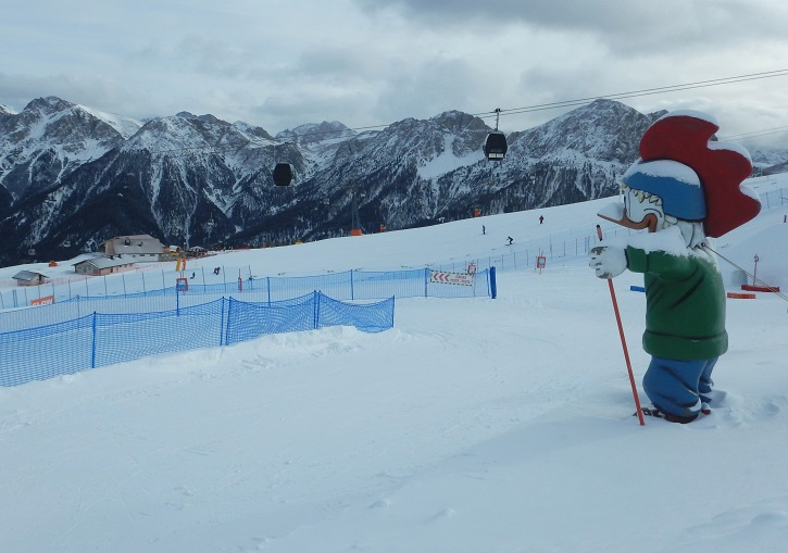 The Kronplatz rooster looks over one of the Kronplatz fun slopes.