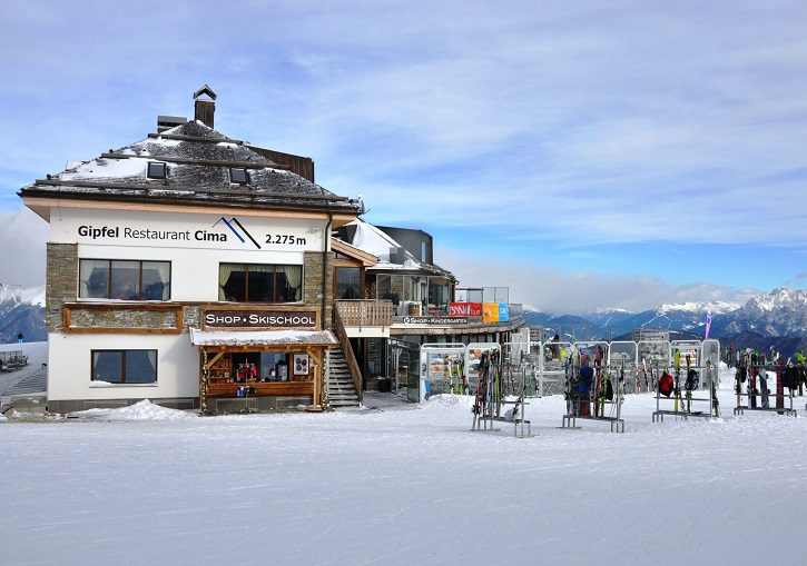 Kronplatz summit restaurant has views to 3 Peaks Dolomites ski resort.
