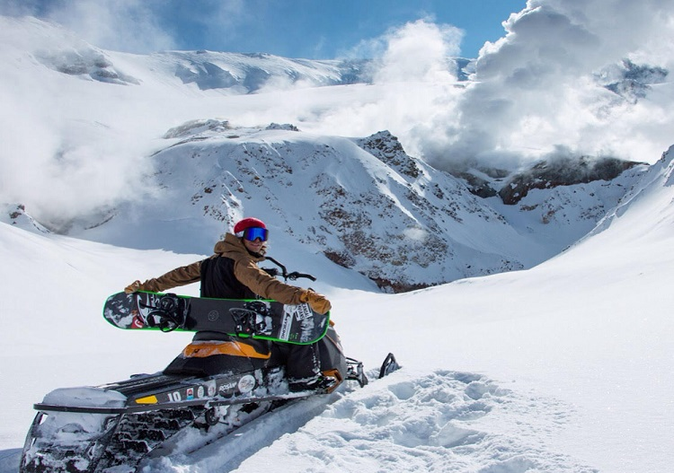 When heliski is not possible, bring out the snowmobile. (photo - Snow Valley)