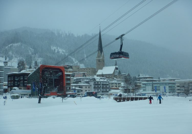 Davos Klosters ski resort. Jakobshorn cable car climbs out of Davos.