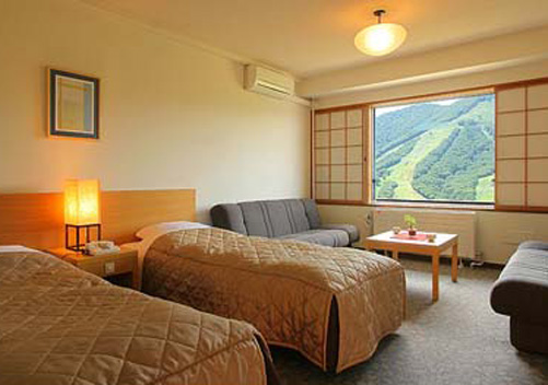 The Madarao Kogen Hotel provides a variety of western style rooms and Japanese/Western style rooms (for 1 - 4 guests per room) and is located ski-in/ski-out at Madarao Kogen ski area.