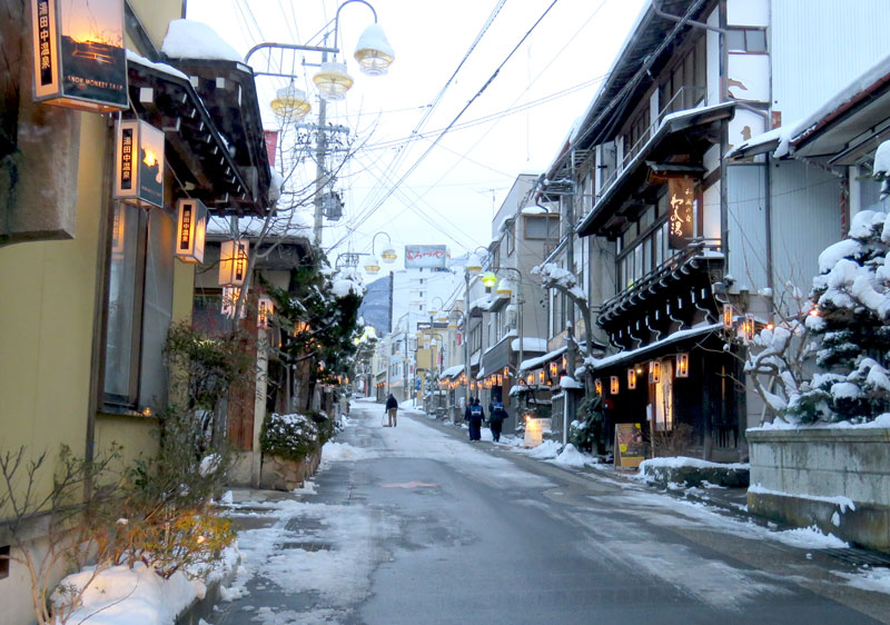 The streets of Yudanaka are lit up at night time